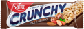 Crunchy bar with nuts and almonds with chocolate coating